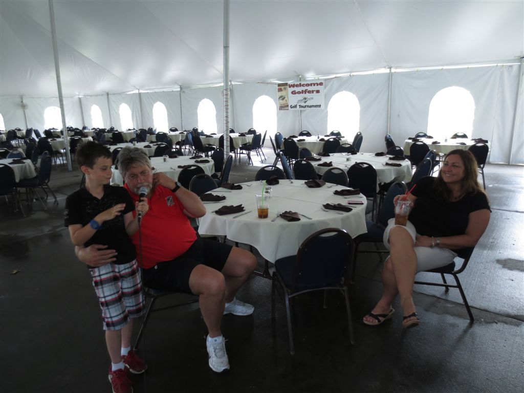 Ben Minster, Jim Lundeen, Joni Sundeen - Completing the sound check on the PA system - and waiting for the golfers to complete the round to have a meal in the tent at Majestic Oaks.